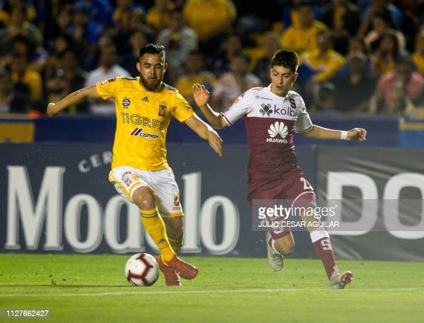 Mexico's Tigres Israel Jimenez vies for the ball with Costa Rica's Deportivo Saprissa Luis Jose Hernandez during a CONCACAF Champions League football...