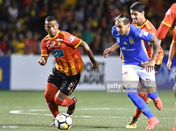 Mexicos Tigres player Ismael Sosa vies for the ball with Costa Rican Herediano Omar Arellano during a Concacaf Champions League football match at the...