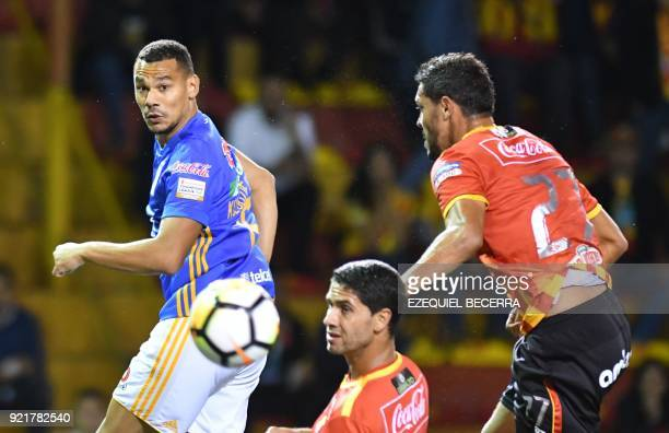Mexicos Tigres Player Timothee Kolodziejczak vies for the ball with Costa Rican Herediano Pablo Salazar and Luis Landin during a Concacaf Champions...