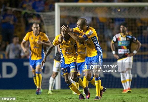 Mexico´s Tigres players celebrate after scoring against Costa Rica's Herediano during the CONCACAF Champions League football match at the...