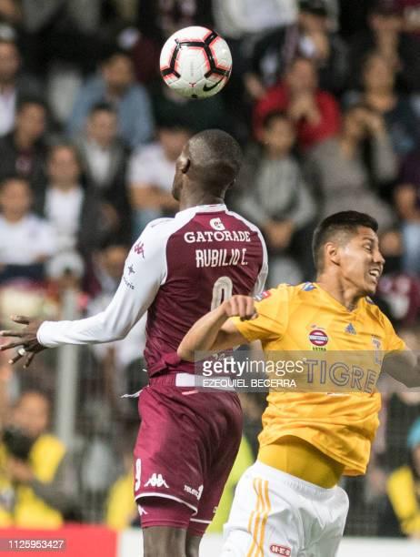 Mexico's Tigres UANL Hugo Ayala vies for the ball with Costa Rica's Deportivo Saprissa Rubilio Castillo during a Concacaf Champions League football...