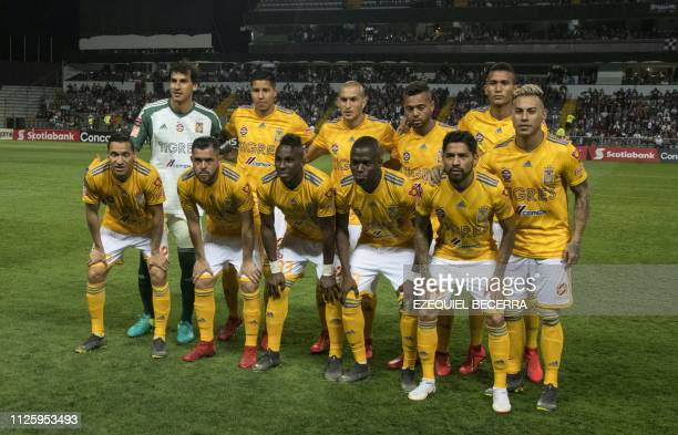 Mexico's Tigres UANL team poses before a match with Costa Rica's Deportivo Saprissa during a Concacaf Champions League football match at the Ricardo...