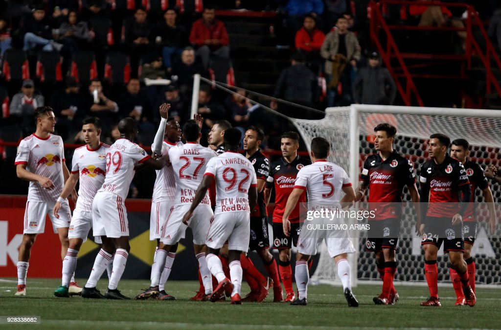 Mexico's Tijuana players (R) and United States' New York confront each other at the end of the first leg of the CONCACAF Champions League quarterfinals match at Caliente Stadium in Tijuana, Mexico on March 6, 2018. New York won 2-0. /