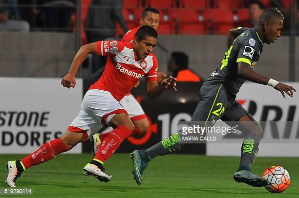Mexico´s Toluca Alexis Vega vies for the ball with Ecuador´s Liga Deportiva Univesitaria de Quito player Enrique Vera during the Libertadores...