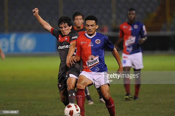 Mexico's Toluca FC player Juan Cuevas vies for the ball with El Salvador's Fas player Williams Reyes during their Concacaf Champions League football...