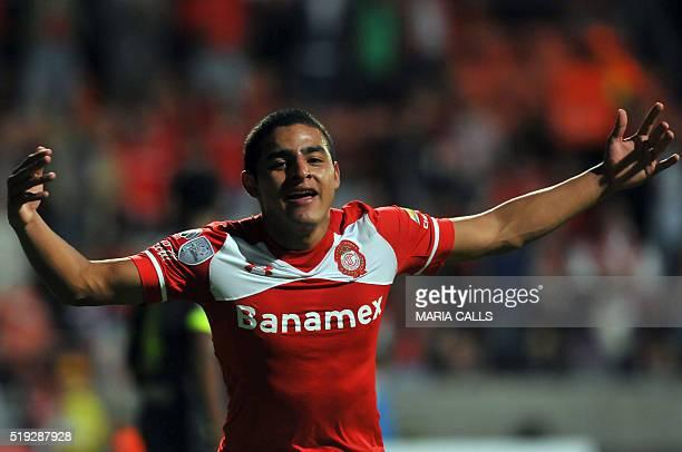 Mexico´s Toluca player Alexis Vega celebrates his goal against Ecuador´s Liga Deportiva Universitaria de Quito during their Libertadores football...