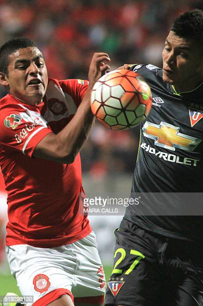 Mexico´s Toluca player Alexis Vega vies for the ball with Ecuador´s Liga Deportiva Univesitaria de Quito player Luis Romero during the Libertadores...