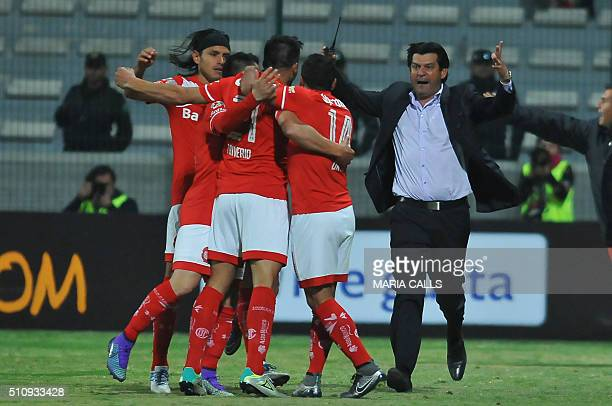 Mexico´s Toluca players and coach Jose Cardozo celebrate their goal against Brazil´s Gremio during the Libertadores cup 2016 football match at...
