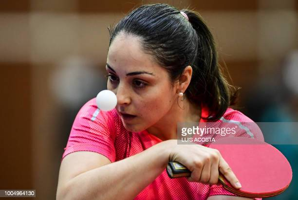Mexico's Yadira Silva eyes the ball during a women's table tennis match against Puerto Rico's Adriana Diaz during the 2018 Central American and...