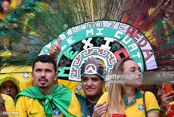 Mexicos's fans cheer before a Group A football match between Brazil and Mexico in the Castelao Stadium in Fortaleza during the 2014 FIFA World Cup on...