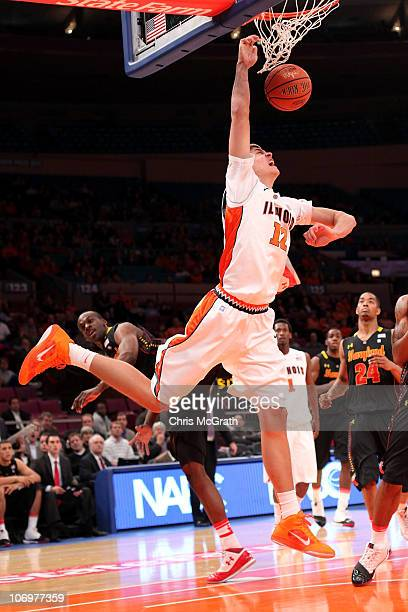 Meyer Leonard of the Illinois Fighting Illini slam dunks against the Maryland Terrapins during the 2k Sports Classic at Madison Square Garden on...