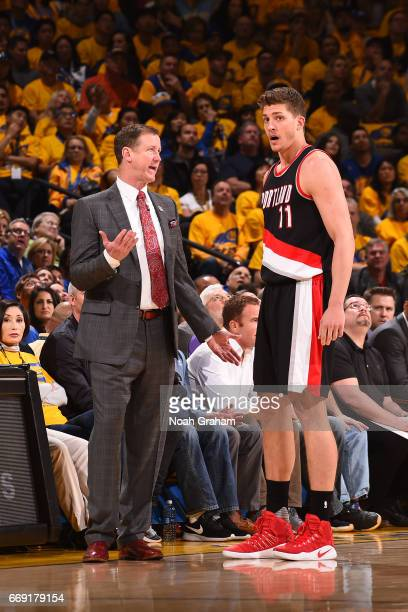 Meyers Leonard and Head Coach Terry Stotts of the Portland Trail Blazers talk during the game against the Golden State Warriors during the Western...