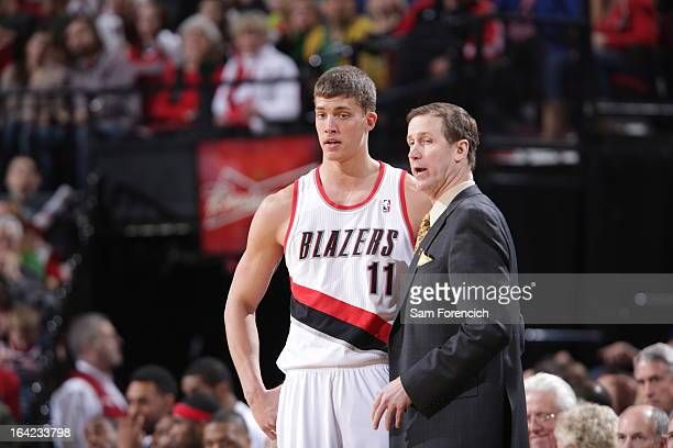 Meyers Leonard and Terry Stotts of the Portland Trail Blazers talk against the Detroit Pistons on March 16 2013 at the Rose Garden Arena in Portland...