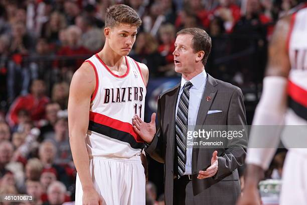 Meyers Leonard and Terry Stotts of the Portland Trail Blazers talk during the game against the Philadelphia 76ers on January 4 2014 at the Moda...