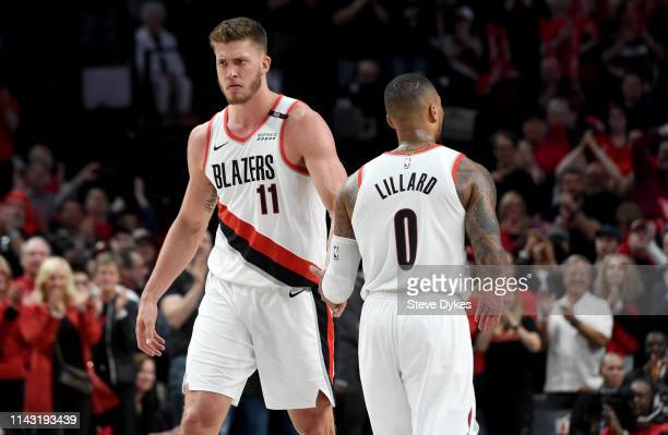 Meyers Leonard celebrates with Damian Lillard of the Portland Trail Blazers during the second half of Game Two of the Western Conference...
