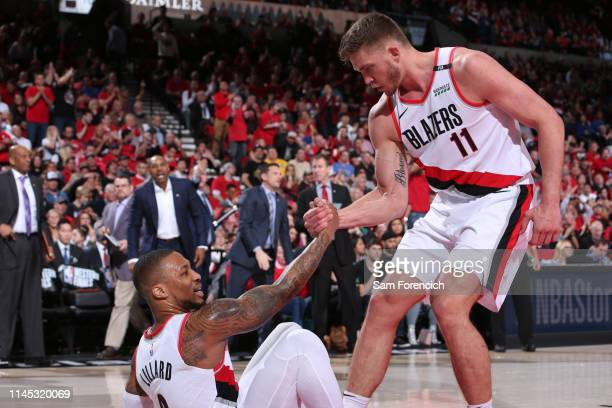 Meyers Leonard helps Damian Lillard of the Portland Trail Blazers from the floor during Game Four of the Western Conference Finals on May 20 2019 at...