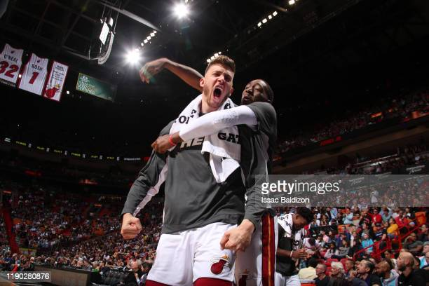 Meyers Leonard of the Miami Heat and Bam Adebayo react to a play during the game against the New York Knicks on December 20 2019 at American Airlines...