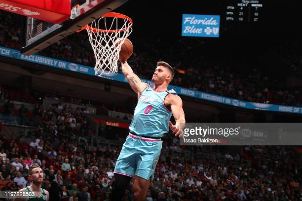 Meyers Leonard of the Miami Heat dunks the ball during a game against the Boston Celtics on January 28 2020 at American Airlines Arena in Miami...