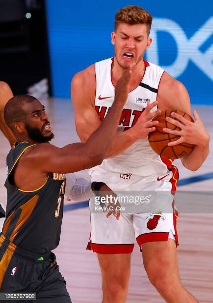 Meyers Leonard of the Miami Heat grabs a rebound against Chris Paul of the Oklahoma City Thunder during the third quarter at Visa Athletic Center at...