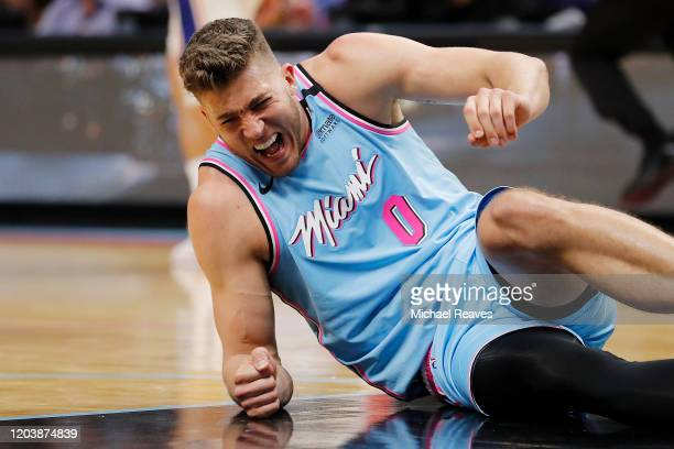 Meyers Leonard of the Miami Heat reacts after being injured against the Philadelphia 76ers during the second half at American Airlines Arena on...