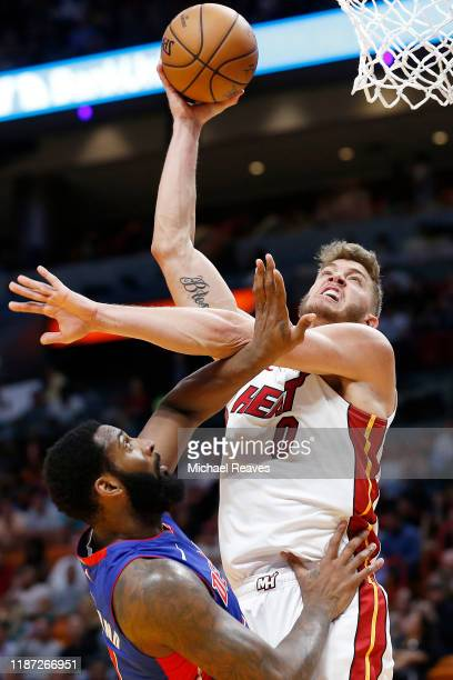 Meyers Leonard of the Miami Heat shoots over Andre Drummond of the Detroit Pistons during the second half at American Airlines Arena on November 12...