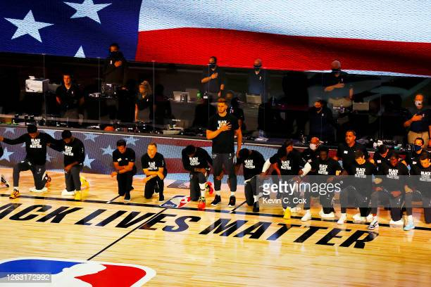 Meyers Leonard of the Miami Heat stands during the National Anthem before the start of a hame against the Denver Nuggets at HP Field House at ESPN...