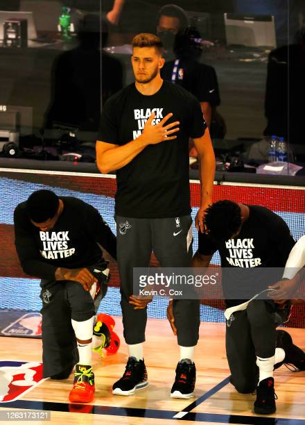 Meyers Leonard of the Miami Heat stands during the National Anthem before the start of a game against the Denver Nuggets at HP Field House at ESPN...