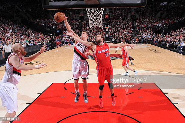 Meyers Leonard of the Portland Trail Blazers and Spencer Hawes of the Los Angeles Clippers go after a rebound during the game on January 14 2015 at...