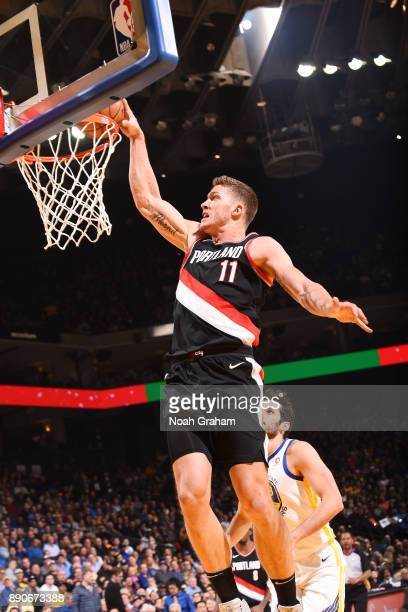 Meyers Leonard of the Portland Trail Blazers drives to the basket against the Golden State Warriors on December 11 2017 at ORACLE Arena in Oakland...