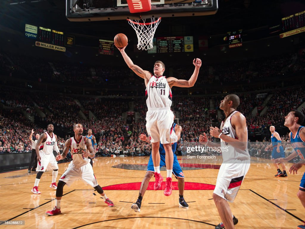 Meyers Leonard #11 of the Portland Trail Blazers grabs a rebound against the New York Knicks on March 14, 2013 at the Rose Garden Arena in Portland, Oregon.