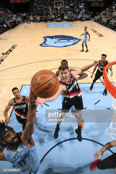 Meyers Leonard of the Portland Trail Blazers grabs the rebound against Mike Conley of the Memphis Grizzlies on December 12 2018 at FedExForum in...
