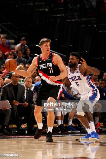 Meyers Leonard of the Portland Trail Blazers handles the ball against the Philadelphia 76ers on December 30 2018 at the Moda Center Arena in Portland...