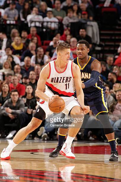 Meyers Leonard of the Portland Trail Blazers handles the ball against Lavoy Allen of the Indiana Pacers during a game on November 30 2016 at the Moda...