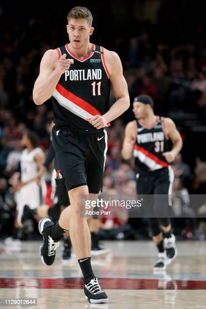 Meyers Leonard of the Portland Trail Blazers points to the team bench after scoring a three point basket in the second quarter against the San...