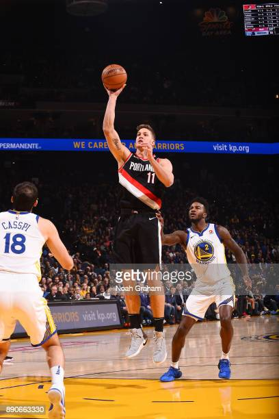Meyers Leonard of the Portland Trail Blazers shoots the ball against the Golden State Warriors on December 11 2017 at ORACLE Arena in Oakland...