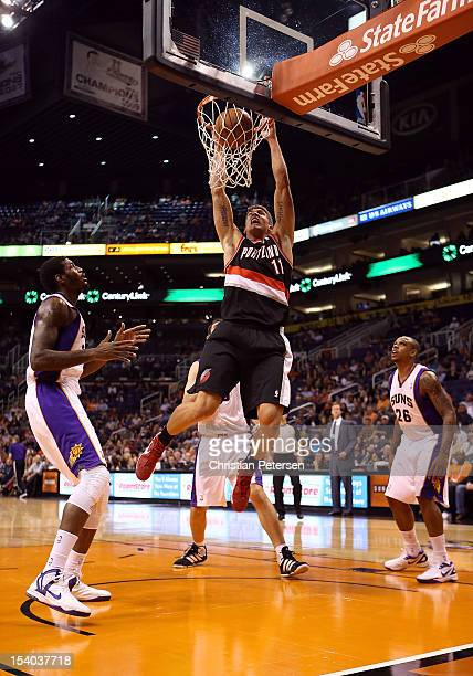 Meyers Leonard of the Portland Trail Blazers slam dunks the ball against the Phoenix Suns during the first half of the preseason NBA game at US...