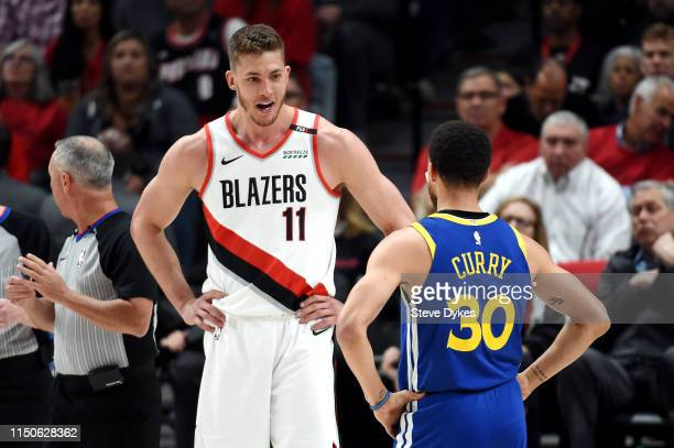 Meyers Leonard of the Portland Trail Blazers talks to Stephen Curry of the Golden State Warriors during the first half in game four of the NBA...