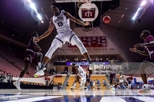 Mezie Offurum of the Mount St. Mary's Mountaineers dunks the ball against the Texas Southern Tigers in the First Four round of the 2021 NCAA Division...