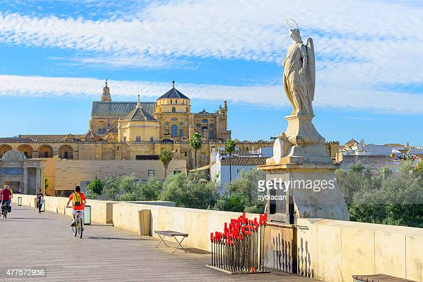 mezquita and st rafael statue on roman bridge - syolacan stock pictures, royalty-free photos & images