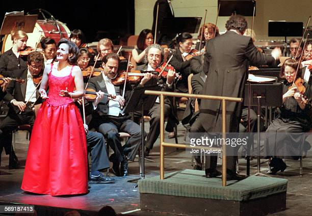 Mezzo soprano Layna Chianakas sings as music director Boris Brott conducts the New West Symphony during their performance of Exotic Adventures at the...