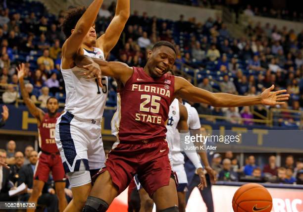 Mfiondu Kabengele of the Florida State Seminoles and Kene Chukwuka of the Pittsburgh Panthers battle for the ball at Petersen Events Center on...