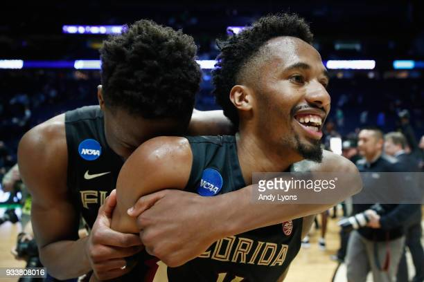 Mfiondu Kabengele of the Florida State Seminoles celebrates with Braian Angola after defeating the Xavier Musketeers in the second round of the 2018...