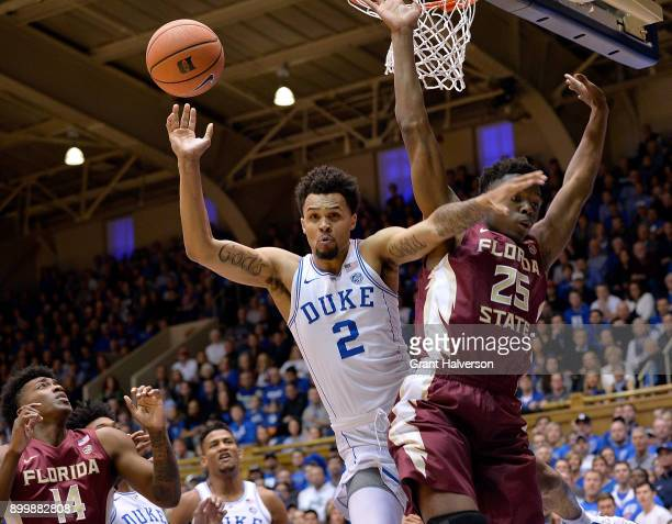 Mfiondu Kabengele of the Florida State Seminoles fouls Gary Trent Jr of the Duke Blue Devils during their game at Cameron Indoor Stadium on December...