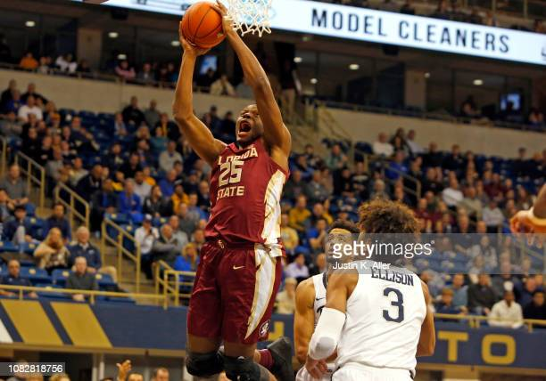 Mfiondu Kabengele of the Florida State Seminoles pulls down a rebound against Malik Ellison of the Pittsburgh Panthers at Petersen Events Center on...