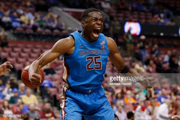 Mfiondu Kabengele of the Florida State Seminoles reacts after a dunk against the Saint Louis Billikens during the Orange Bowl Basketball Classic at...