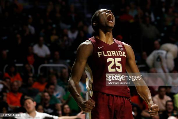Mfiondu Kabengele of the Florida State Seminoles reacts against the Miami Hurricanes during the first half at Watsco Center on January 27, 2019 in...