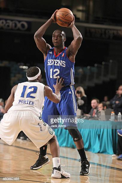Mfon Udofia of the Delaware 87ers looks to pass the ball against the Reno Bighorns during the 2014 NBA DLeague Showcase presented by Samsung Galaxy...