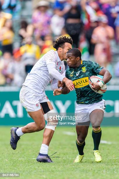 Mfundo Ndhlovu of South Africa fights Ryan Olowofela of England during the HSBC Hong Kong Sevens 2018 match between South Africa and England on April...