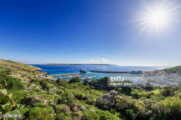 mgarr harbour, gozo on a clear winter day - insel gozo malta stock-fotos und bilder