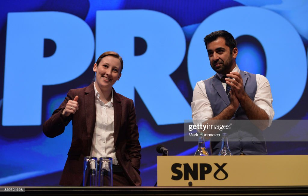 Mhairi Black MP (L), and Humza Yousaf MSP, receives applause from delegates ahead of First Minister & SNP Leader Nicola Sturgeon's keynote speech at The SNP Autumn Conference 2017 at the Scottish Exhibition and Conference Centre on October 10, 2017 in Glasgow, Scotland. The Scottish National Party have gathered in Glasgow for the 83rd annual National Conference. Over the three day period the conference will set out their plans for the future of Scotland.